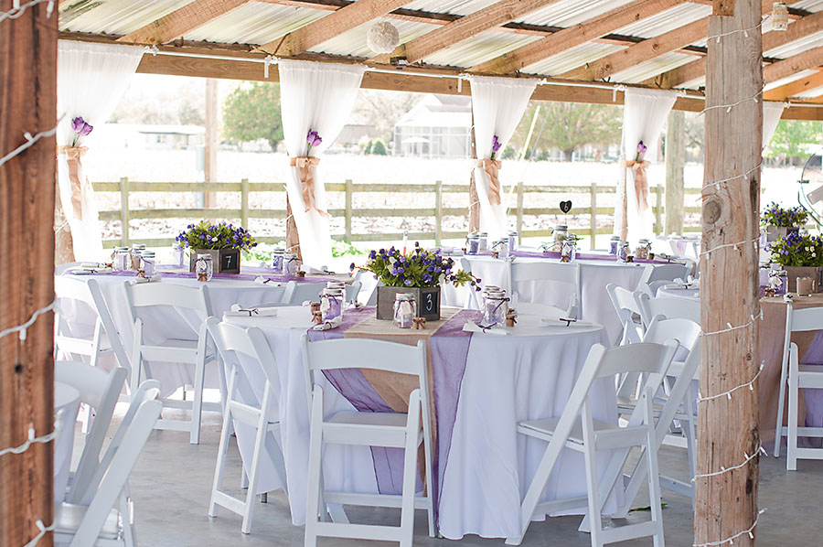 rustic reception with burlap table runners and wooden boxes