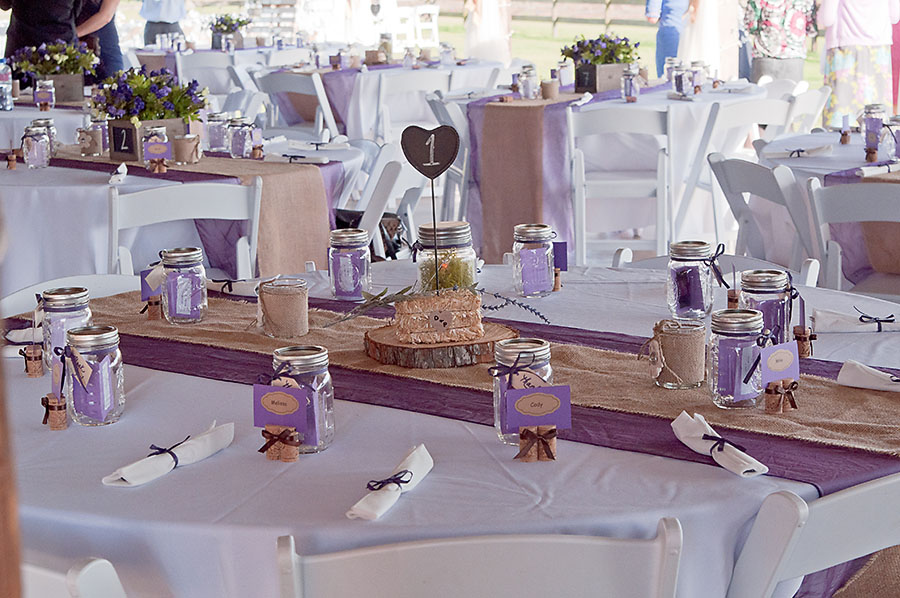 Rustic reception, wooden charger, hay bale, wine cork name tags