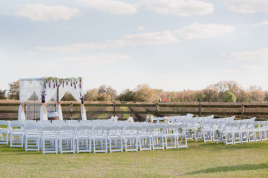 Rustic ceremony setup, wooden arch and wine barrel
