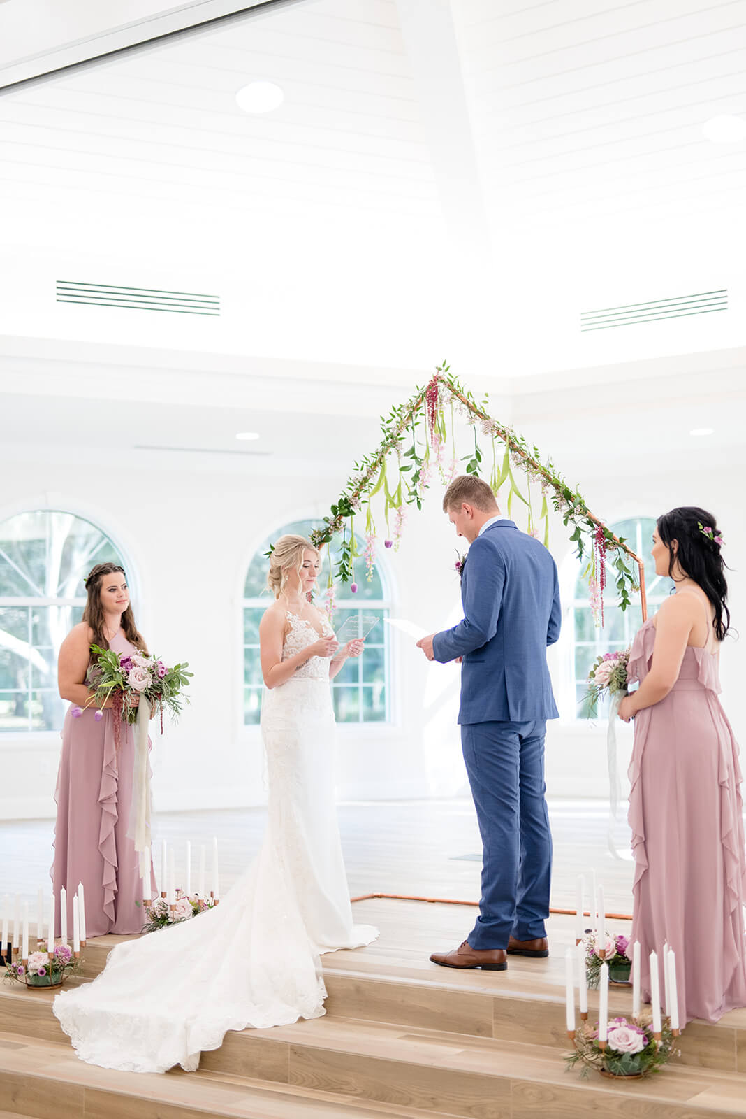 white lighting, copper wedding arch piping