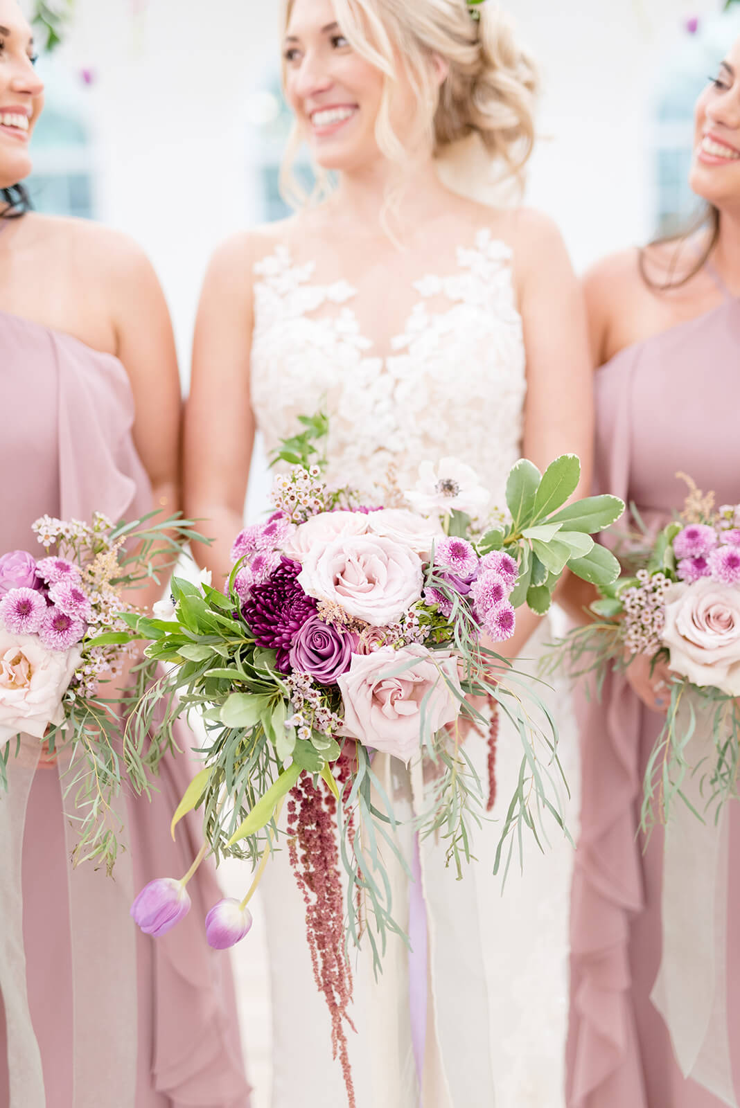 bridal bouquets with purples, pinks and neutrals