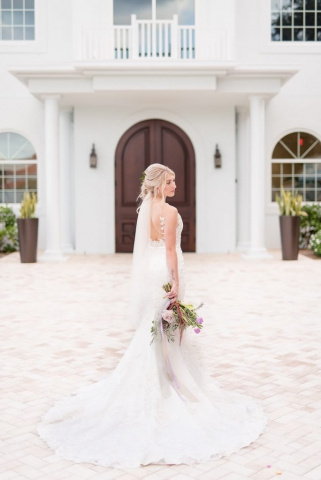 bride look back photo, long white dress with back veil