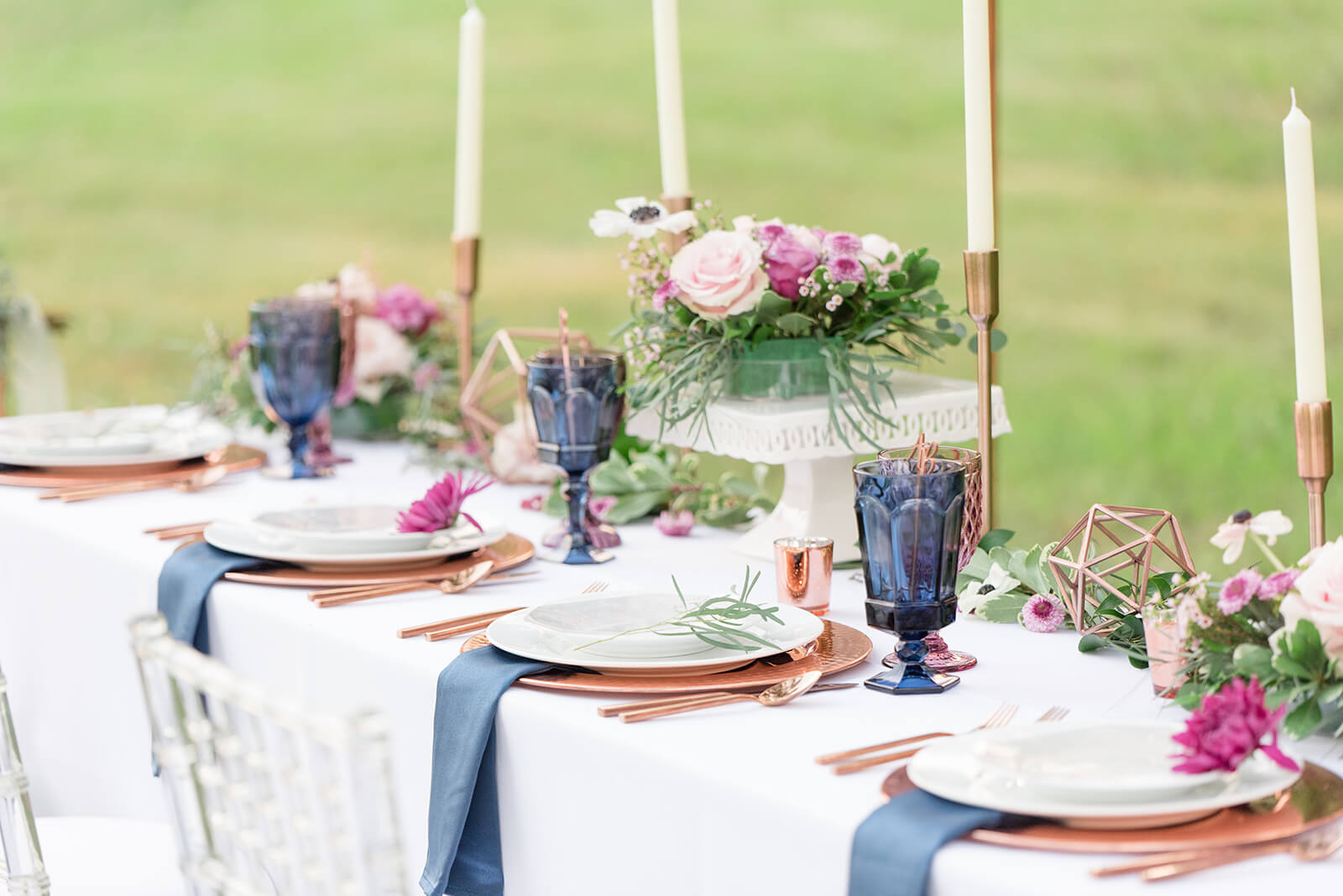 white table cloth with copper chargers and purple and blue placesettings