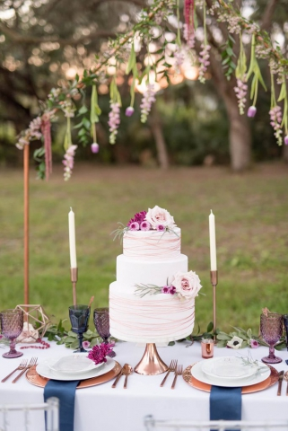 blue and purple reception table decor, with gold candle sticks