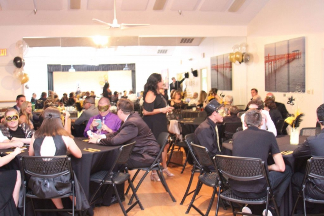 black and gold decor, room of 50 people