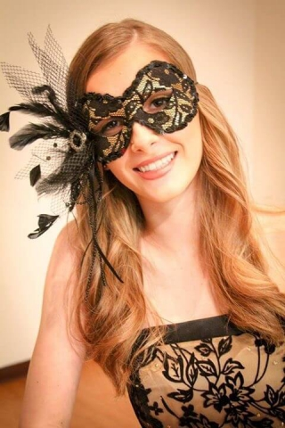 black and gold female mask, black and gold dress