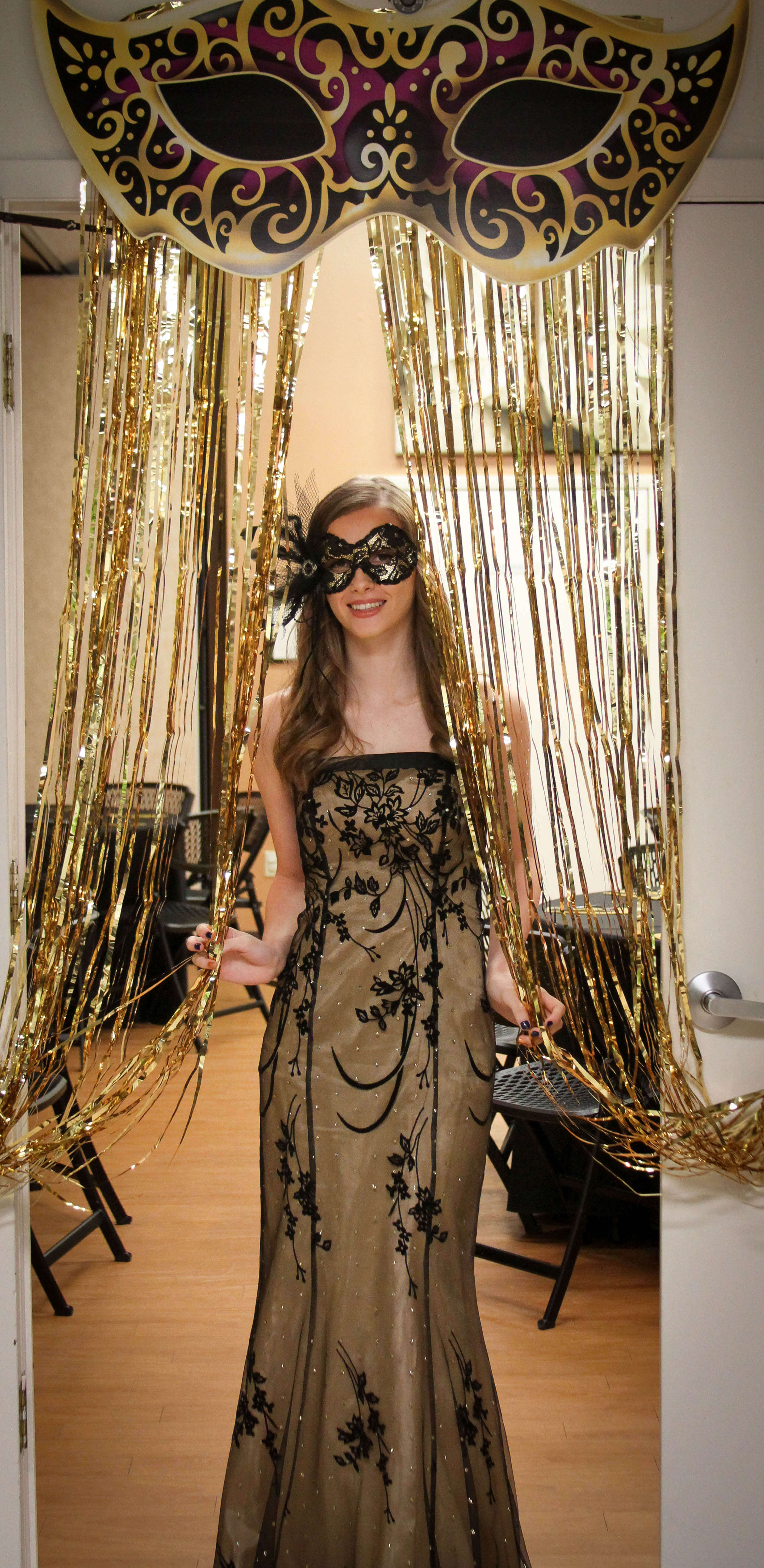 black and gold dress, black and gold mask with gold streamers