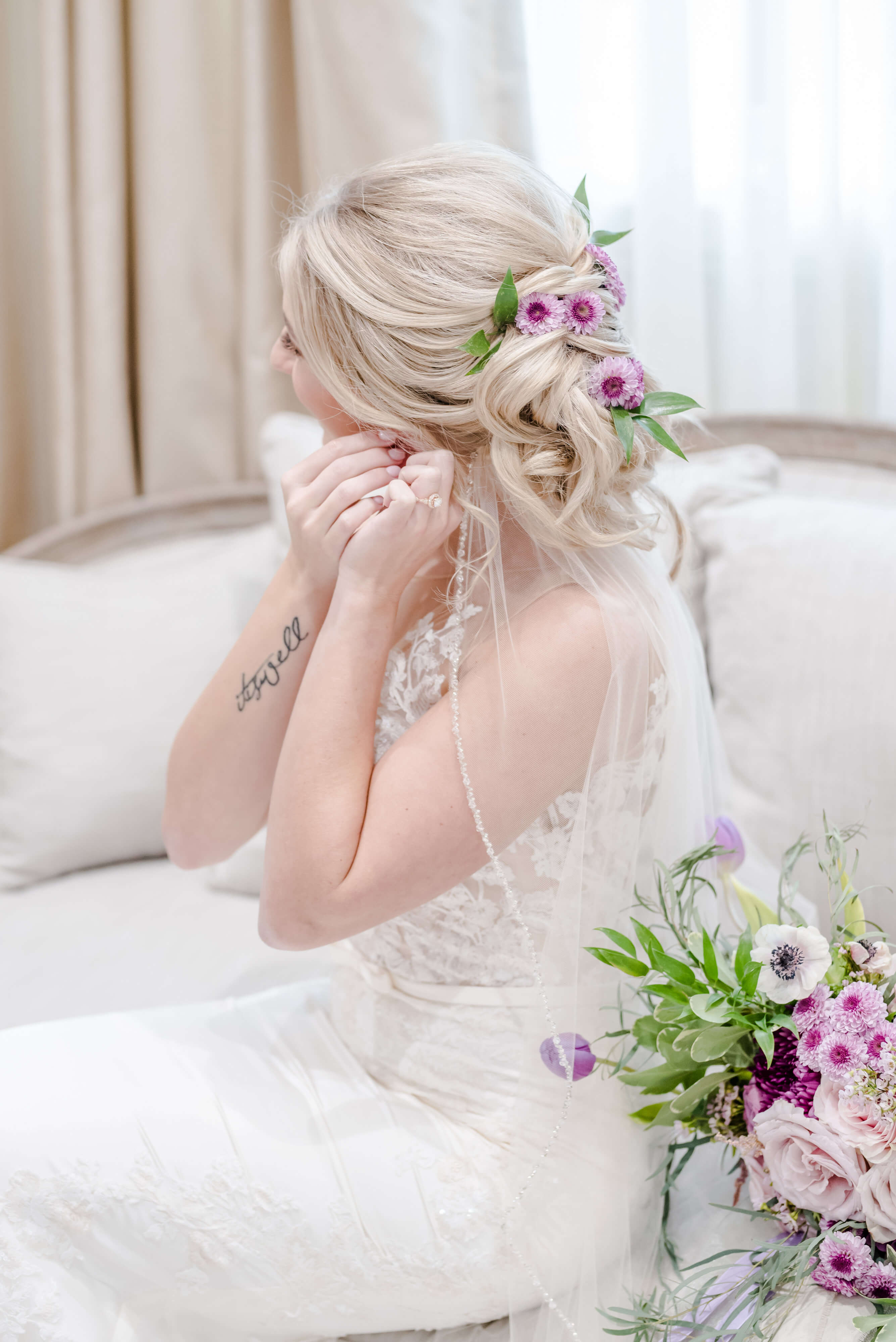 purple bridal florals for bouquet and hair, bride getting ready
