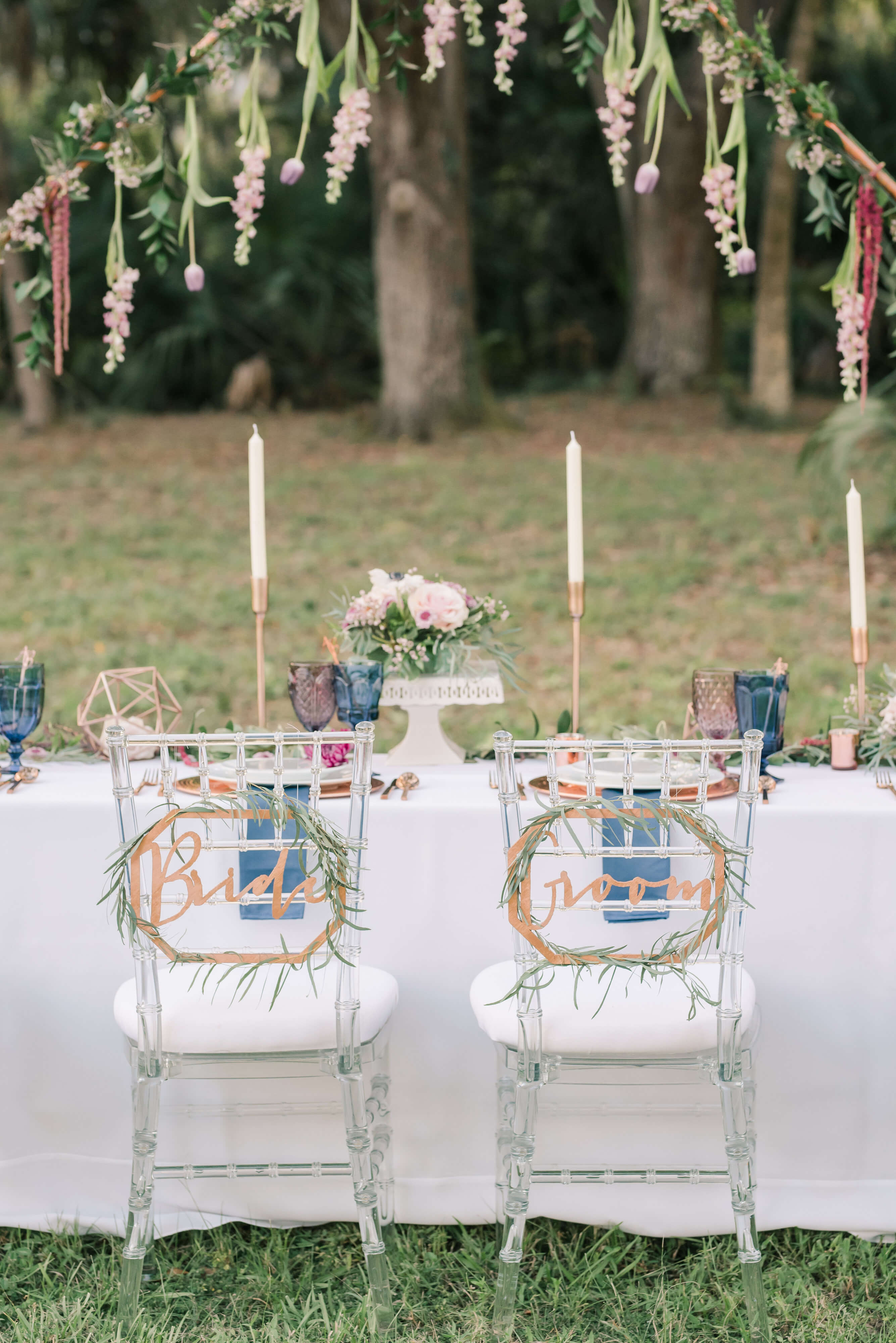reception table setting, purple, blue and copper, floral arch
