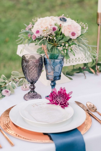 purple and blue glasses with copper dishes, magenta floral