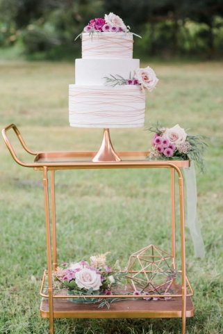 Copper cake stand and geo decor with copper breakfast cart